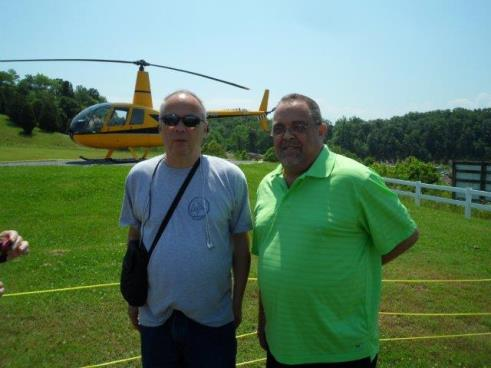 Picture of my twin brother and me standing in front of a helicopter